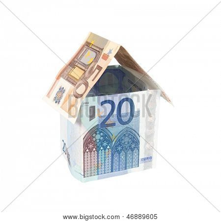 House made of Euro money isolated on white with clipping path