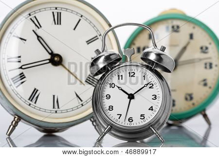 Three old classical alarm clocks