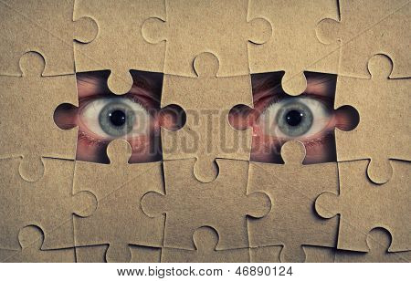 Eyes look out from the holes in jigsaw puzzle