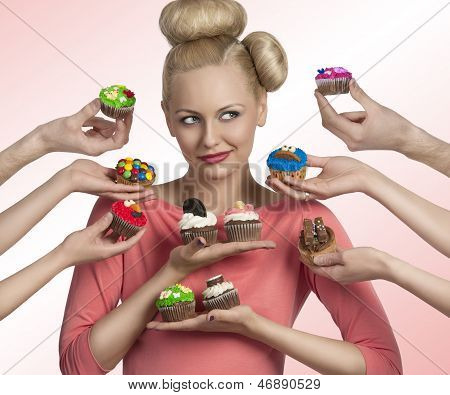 Girl And Some Hands With Cupcakes