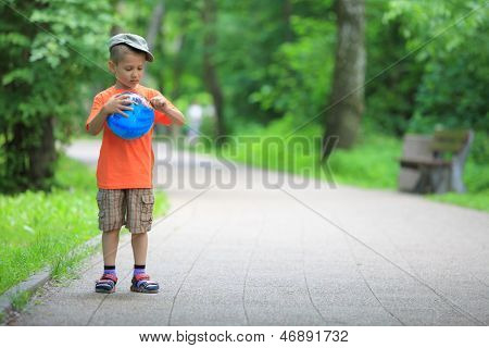Boy Playing With Ball In Park Outdoors