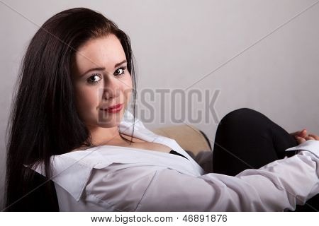 Portrait Of Long-haired Woman In A White Men's Shirt