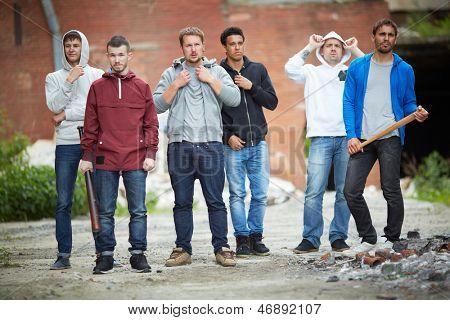Portrait of spiteful guys on the street