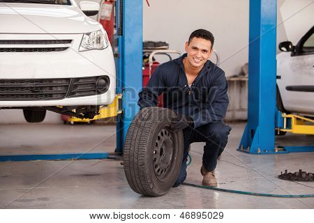 Happy mechanic loving his job