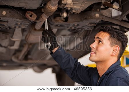 Fixing a car at an auto shop