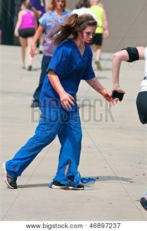 Female Zombie Nurse Chases Runner In 5K Race