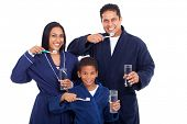 picture of nightgown  - healthy young indian family brushing teeth together in pajamas - JPG