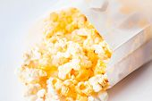 Close Up Butter Popcorn Falling Out Of Paper Bag
