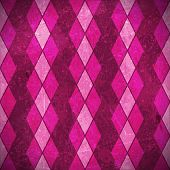Geometric pattern made of rhombuses in various bright pink, purple, magenta colors overlaid with gru
