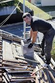 pic of shingles  - Roofer replacing shingles - JPG