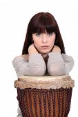 picture of bongo  - Brunette leaning on bongo drum - JPG