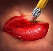 stock photo of libido  - Losing sex drive and loss of sexual desire as a health care concept of human sexuality and relationship challenges with the red lips of a woman that are being erased by a pencil - JPG