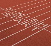 foto of track field  - Fast track business concept as a journey from start to the finish line as an icon of quick service and planning a short and long term strategy for success with a track and field in a sports stadium - JPG