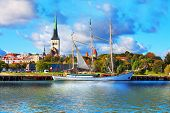image of sailing vessels  - Scenic summer panorama of pier with historical tall sailing ship in the Old Town in Tallinn - JPG