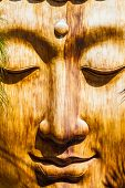 pic of siddhartha  - a zen wooden sculpture in an ancient oriental temple - JPG