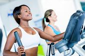 stock photo of cardio exercise  - Fit women exercising at the gym on an x - JPG