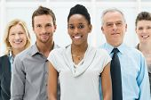 stock photo of afro  - Happy smiling multi ethnic business team in office - JPG