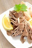 picture of tripe  - entrails of stomach of beef cooked in salted water with lemon juice called trippa tripe - JPG
