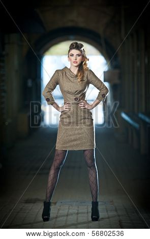 Attractive elegant blonde young woman wearing an elegant outfit in urban fashion shot