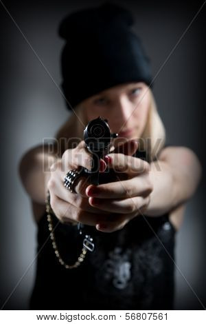 Portrait Of A Young Girl With A Gun