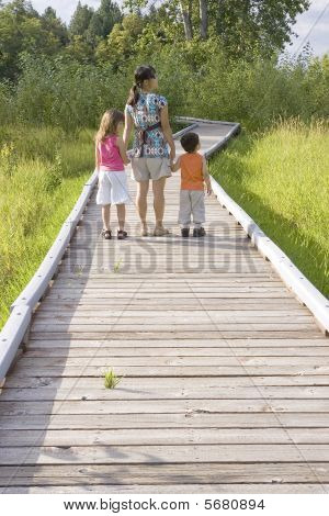 Mother and children take a walk in nature.