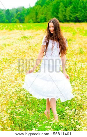 Russian Beauty In A Rural Field With Flowers
