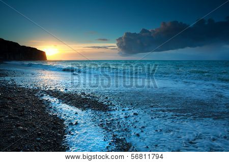 Sunset Over Stone Beach In Atlantic Ocean