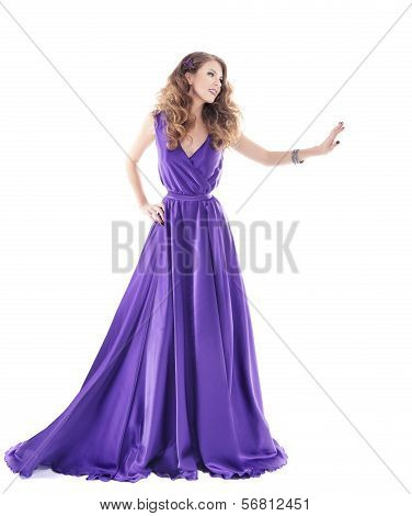 Woman Showing Advertisement In Purple Silk Dress Over White Background