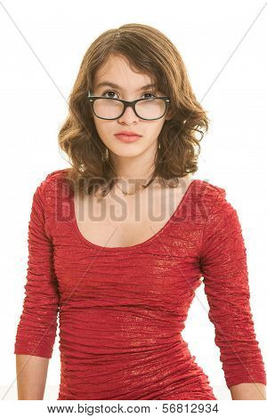 Pretty teen brunette girl in red dress with eyeglasses