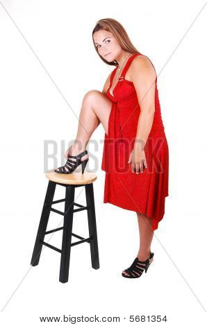 Woman Standing On Chair.