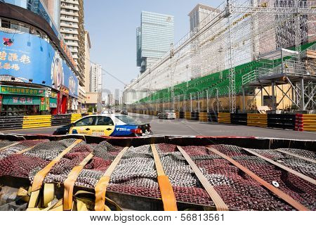 MACAU, CHINA - NOVEMBER 2, 2012: Preparation track and construction of seats for spectators for race Macau Grand Prix in stages Formula 3, FIA WTCC, motorcycle prize. Race takes place on the streets.