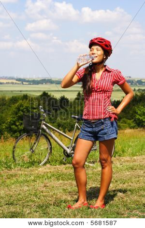 Biking Woman Drinking Water