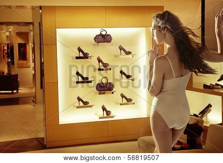 Fashion woman looking at high-heel shoes