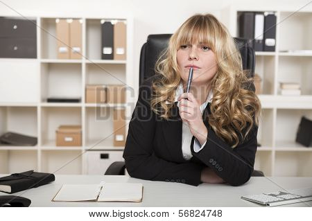 Young Businesswoman Sitting Thinking