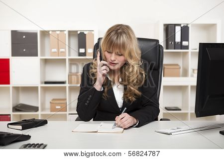 Attractive Businesswoman Chatting On The Phone