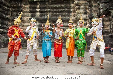SIEM REAP,CAMBODIA-NOV 20, 2013:An unidentified cambodians in national dress poses for tourists in Angkor Wat,on Nov 20, 2013,Siem Reap,Cambodia.Angkor is the country's prime attraction for visitors.