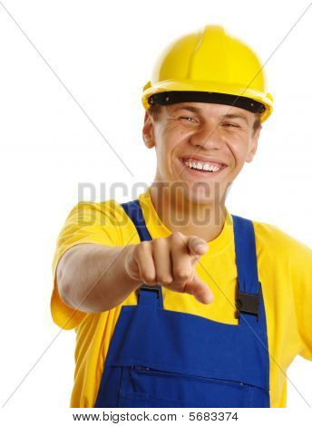 Happy Young Worker Pointing At You And Smile