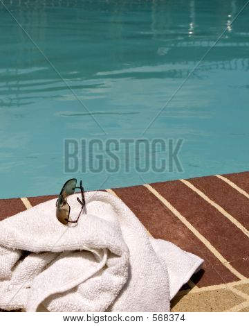Sun Glasses, Towel And A Pool