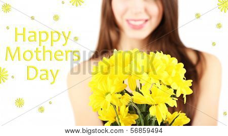 Young beautiful girl with nice flowers in her hand, isolated on white