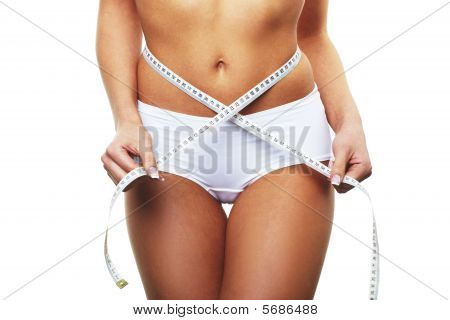 Fit Girl Measuring Her Rear To See If She Has Had Any Weight Loss