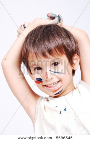 Little Cute Kid With Colors On His Face
