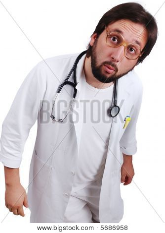 Young Male Doctor In White Standing Close Up With Funny Surprised Face