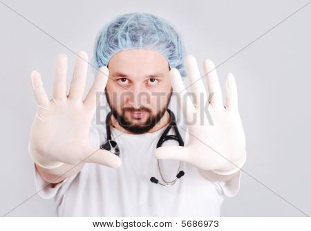 Young Male Doctor With Hands In Front And Surgery Gloves On