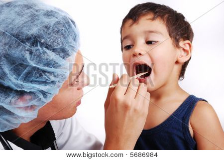 Young Male Doctor Is Taking Care Of Little Cute Kid