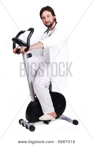 Young Male Doctor Is Riding Sport Bicycle