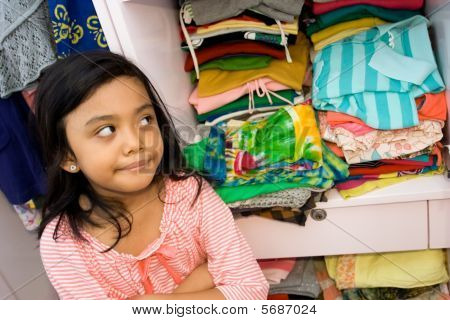 Little Girl And Her Clothing Collection