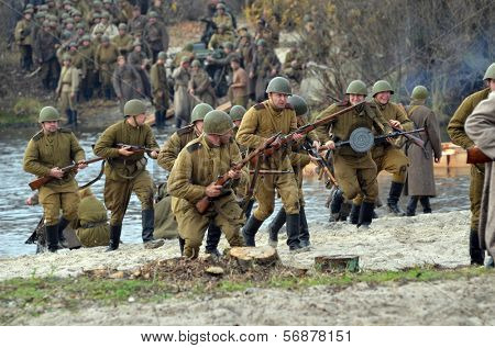 KIEV, UKRAINE -NOV 3: An unidentified members of Red Star history club wear historical Soviet uniform during historical reenactment of WWII, Battle for Kiev 1943 on November 3, 2013 in Kiev, Ukraine