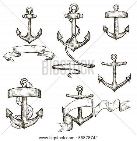 set of hand drawn anchors and ribbons