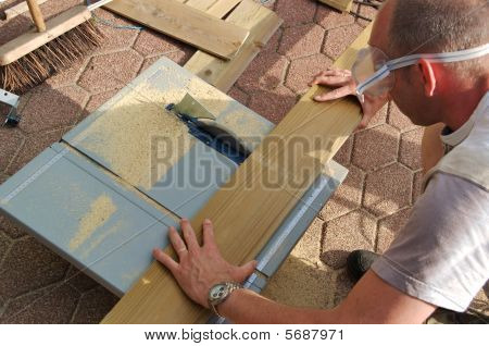 Carpenter Working With Table Saw