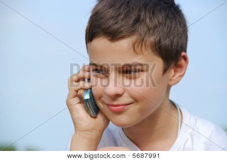 Young Boy Making A Phonecall